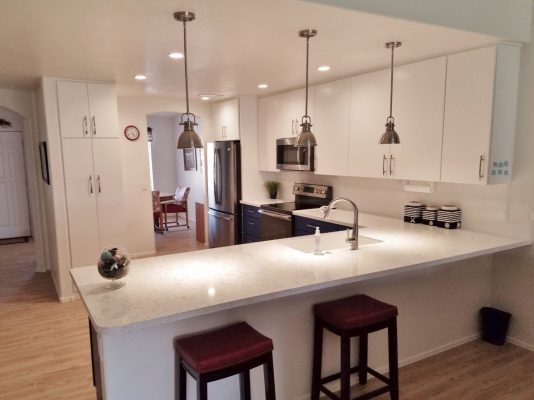 Kitchen Remodel with White Appearance by Stradlings Cabinets